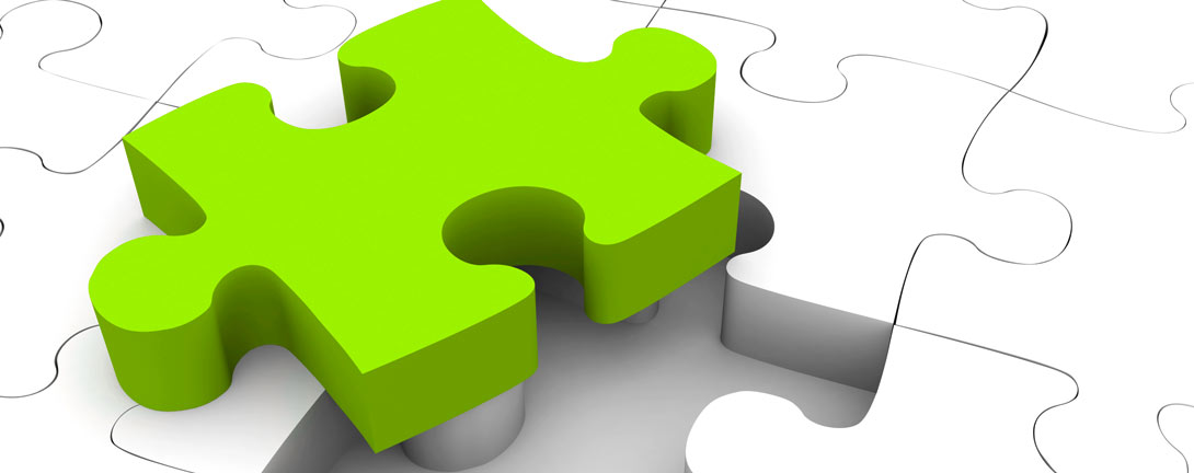 Zusammenpassende Puzzleteilen in grün und weiss.